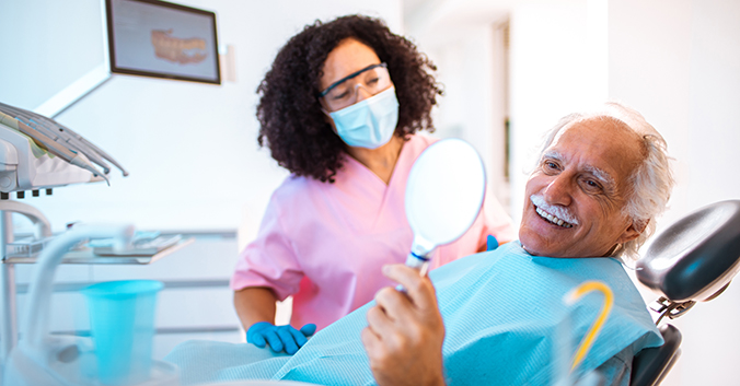 Close-up of a senior man having a dentist appointment
